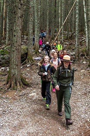 ranger leads line of kids in forest