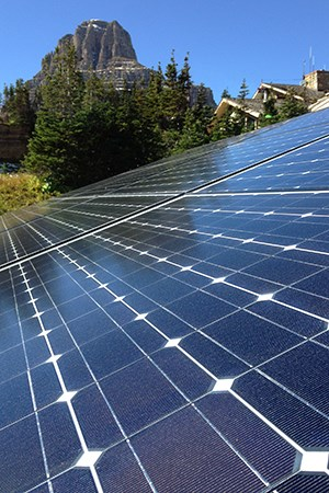 solar panel with mountain and roofline in background