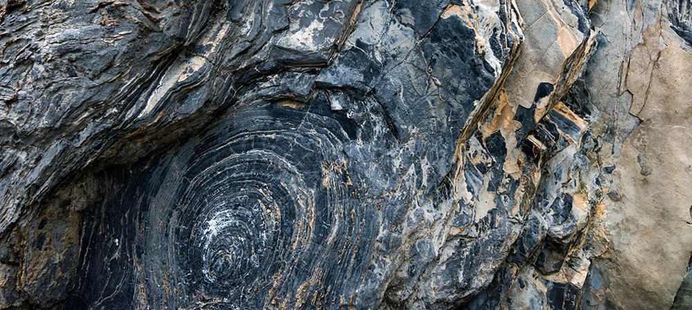 round layered formation in dark rock