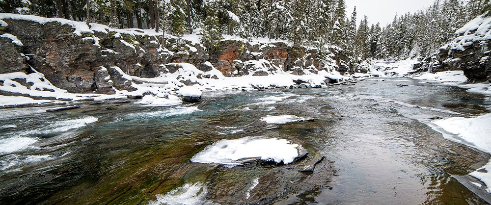 snow-covered river banks