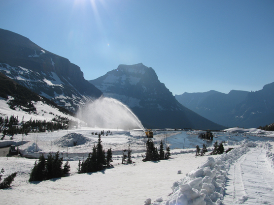 Rotary plow blowing snow out of the Logan Pass Visitor Center parking lot on July 7, 2011