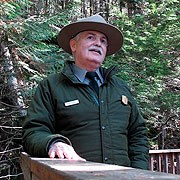 Bill in uniform giving an outdoor talk