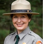 Headshot of smiling ranger in flat hat