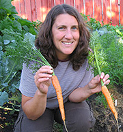 Melissa holding home-grown carrots