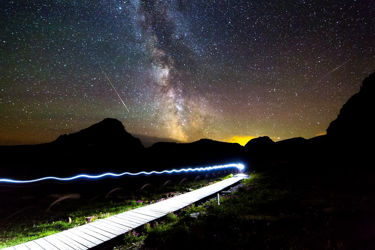 Hiker under the Milky Way