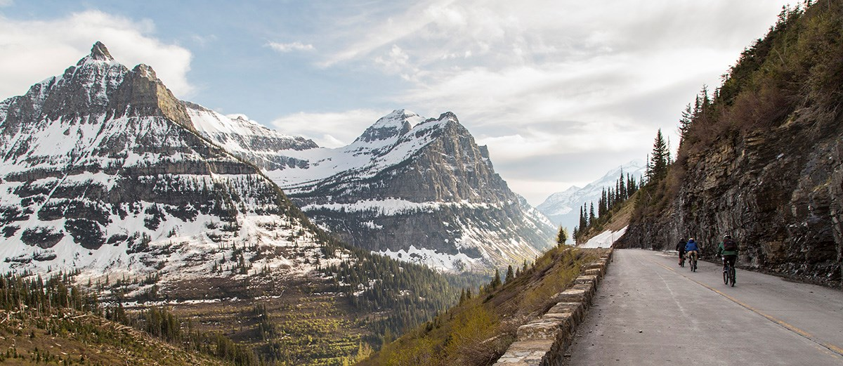 Bikers riding the Going-to-the-Sun Road past Weeping Wall