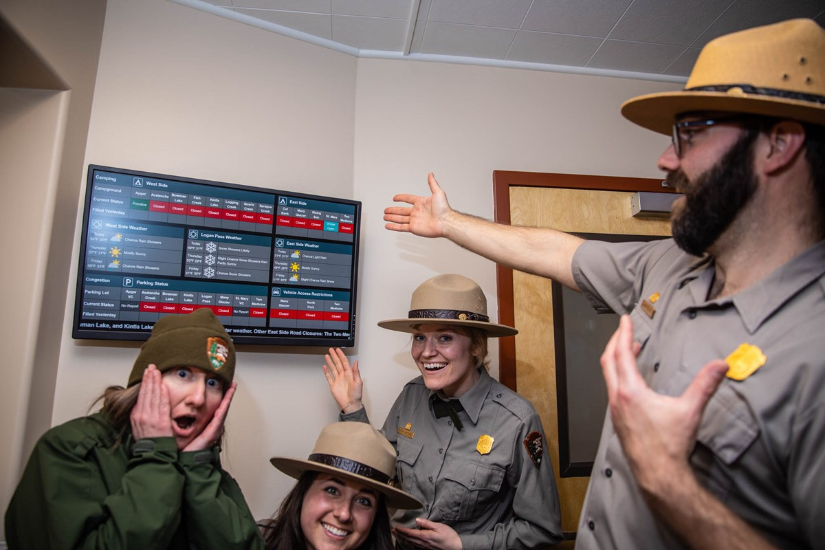 Four rangers are very excited about a display screen.
