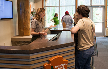 ranger at info desk talks to visitors