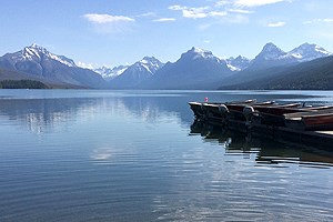 Mountain range, lake, aluminum boats on dock