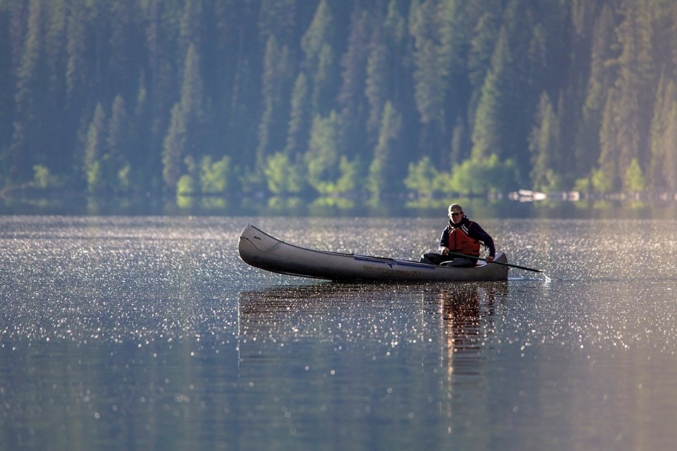 canoe on lake in Glacier National Park