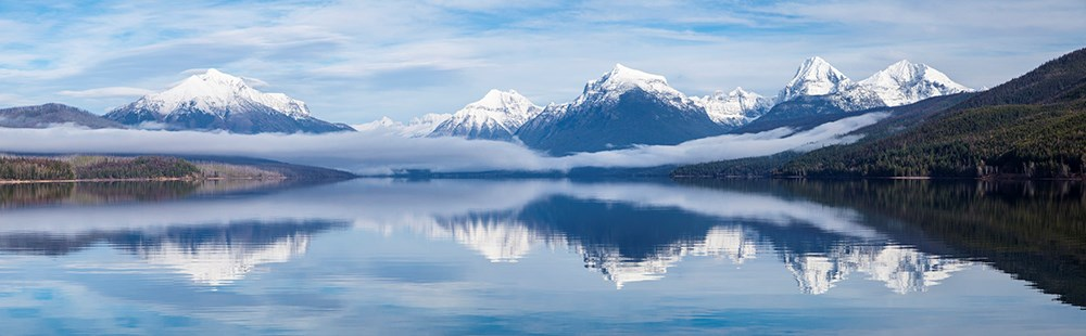 Lake with mountains and low fog