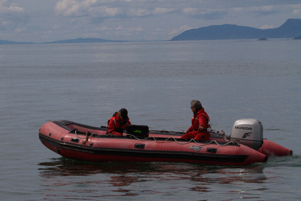 researchers in red inflatable boat