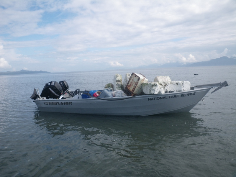 Skiff filled with beach trash