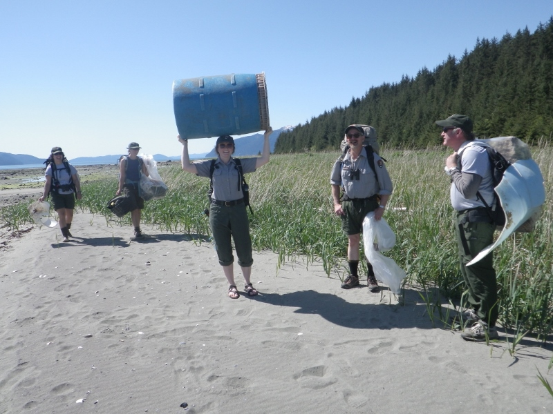 NPS staff collect trash on the beach