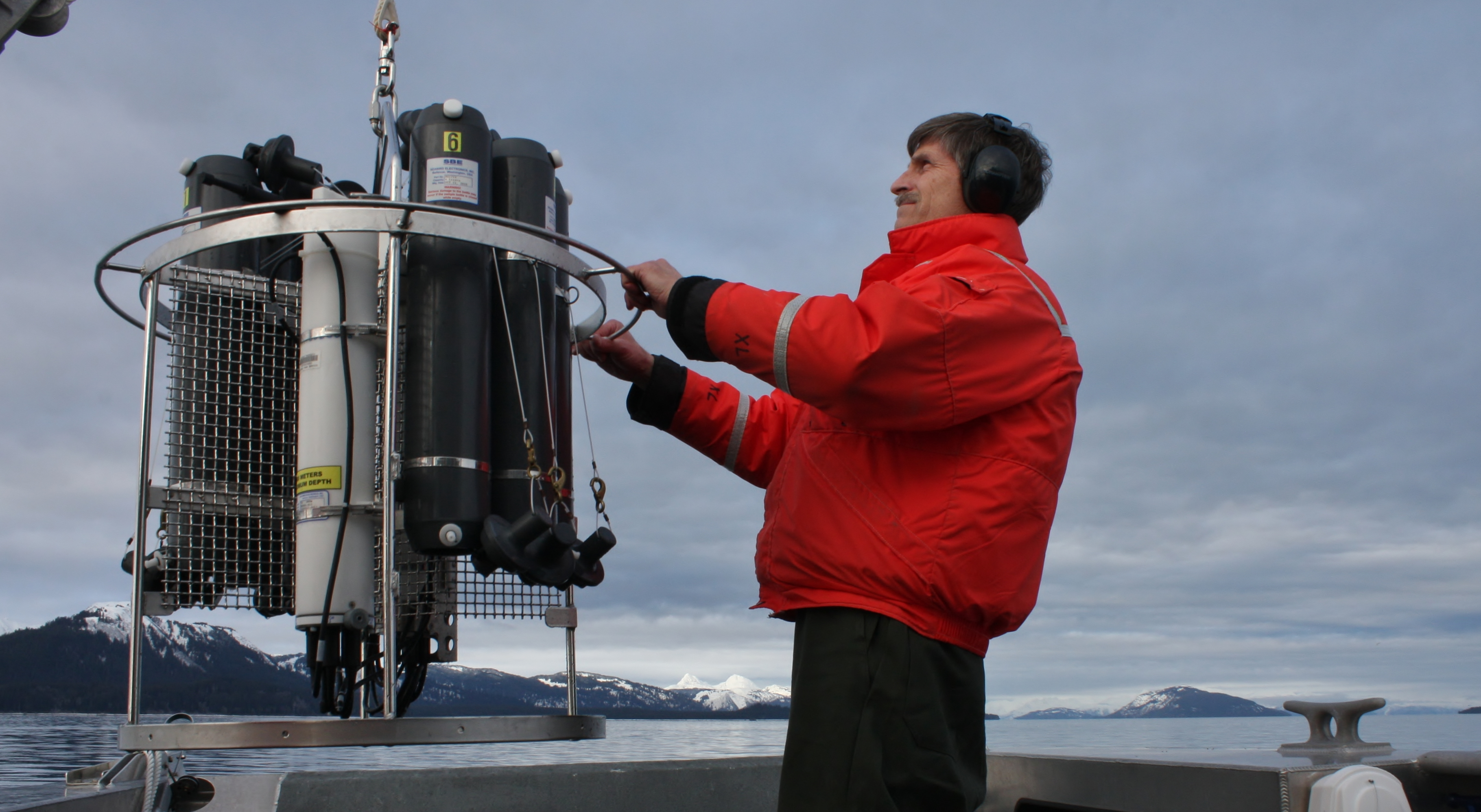 A researcher with ceanography survey equipment