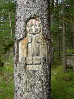 Eagle carving on spruce tree in Bartlett Cove.