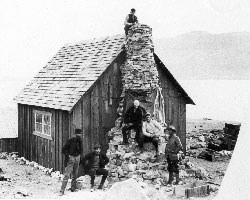 John Muir and geologists at his Glacier Bay cabin