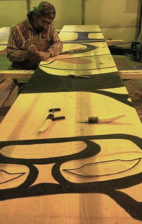 Tlingit carver working on house screen