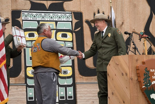 Leaders of Glacier Bay National Park and the Hoonah Indian Association shaking hands