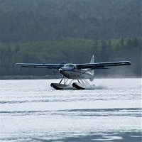 a float plane lands on water