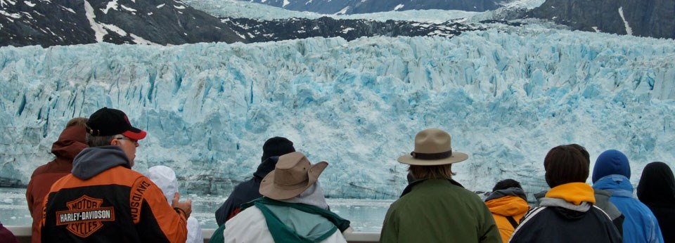Ranger and visitors viewing glaciers