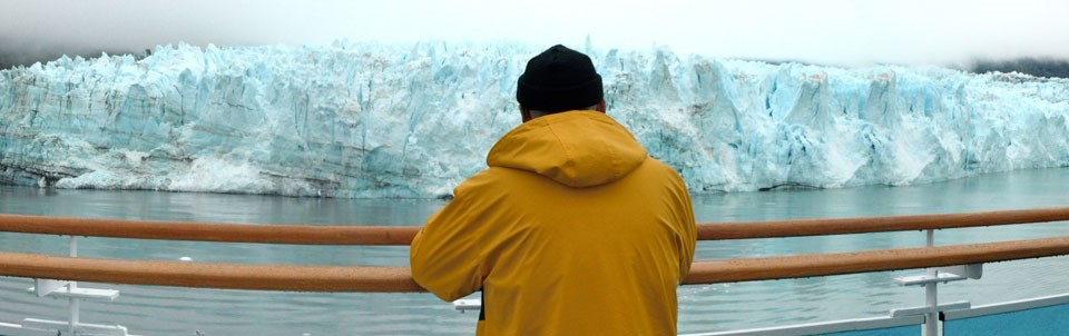 Man viewing a glacier from a cruise ship