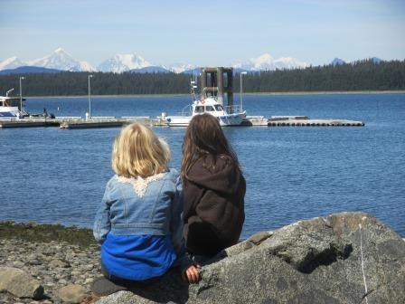Two girls look out at Glacier Bay