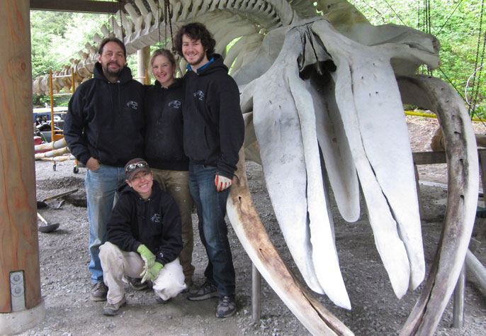 The Whales and Nails articulation team stands proudly in front of the completed skeleton display.