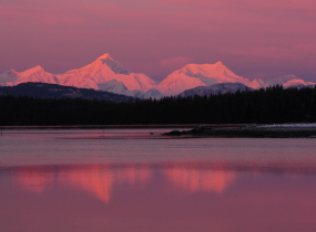 A pink sunset over the Fairweather Mountains.
