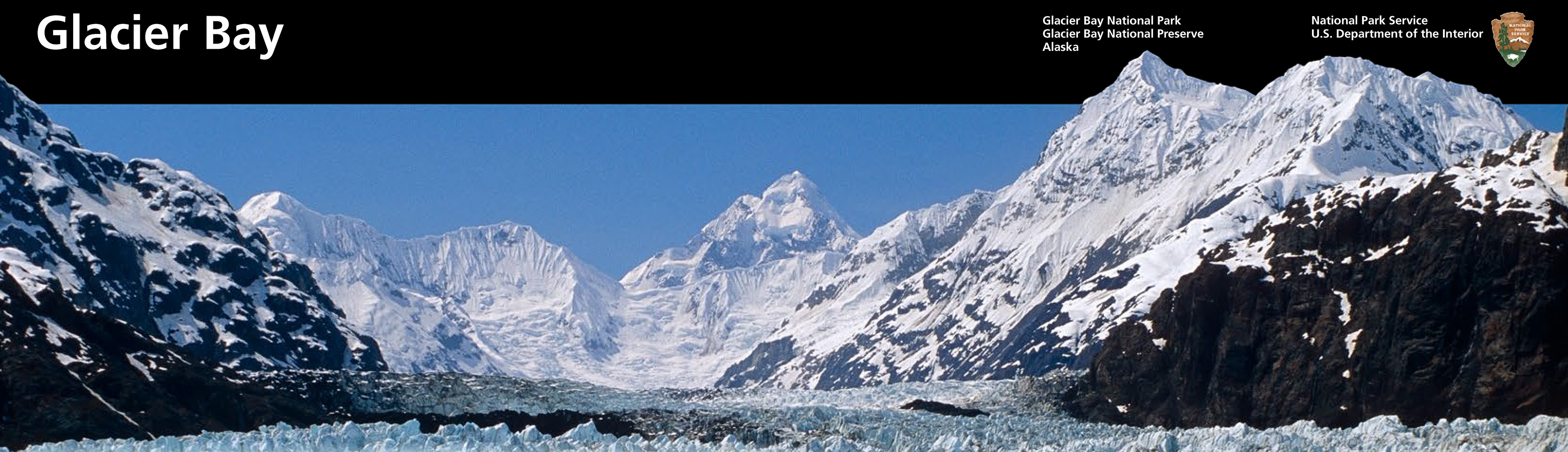 A Glacier Leads High Into Steep Rocky Snow-topped Mountains. Graphic Layout For Glacier Bay At Top - A glacier leads high into steep rocky snow-topped mountains. Graphic layout for Glacier bay at top