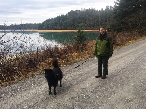 Visitor with dog in Bartlett Cove