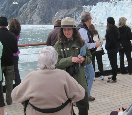 Passenger in wheelchair enjoying Glacier Bay with a park ranger