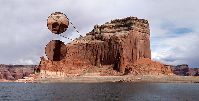 A large butte on Lake Powell. Callout frames indicate people on the sides of the wall.