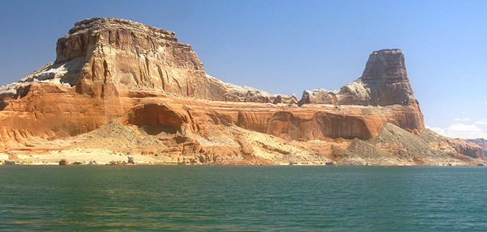 A curvy butte rises from the waters of Lake Powell.