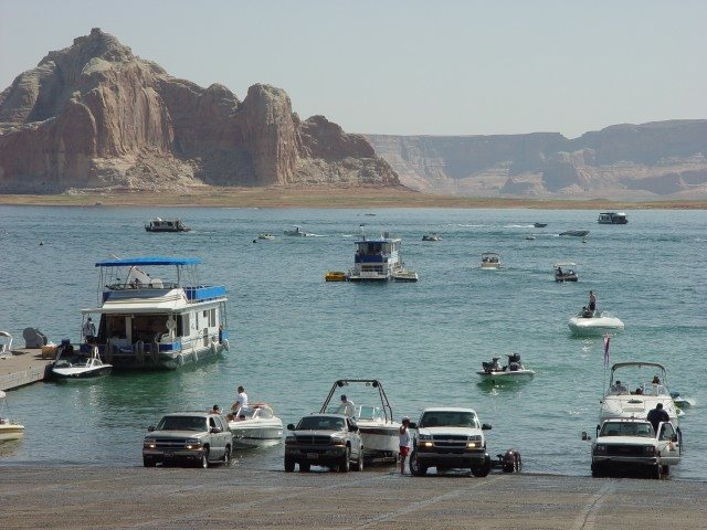 View from Wahweap boat ramp showing a busy day with boats of all sizes launching and operating on Lake Powell