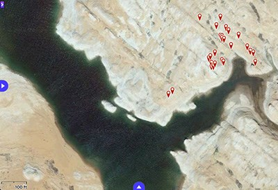 Satellite view of Lake Powell, with many red marker points