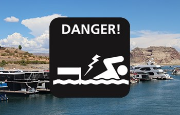 do not swim near docks icon overlaid on photo of houseboats in marina