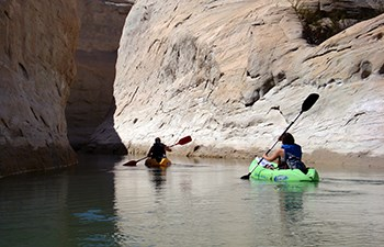 Two kayakers enter side canyon
