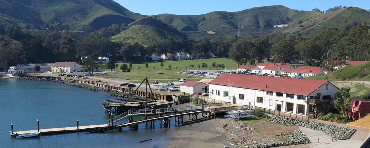 Fort Baker water front with buildings, large lawn and headlands in the background