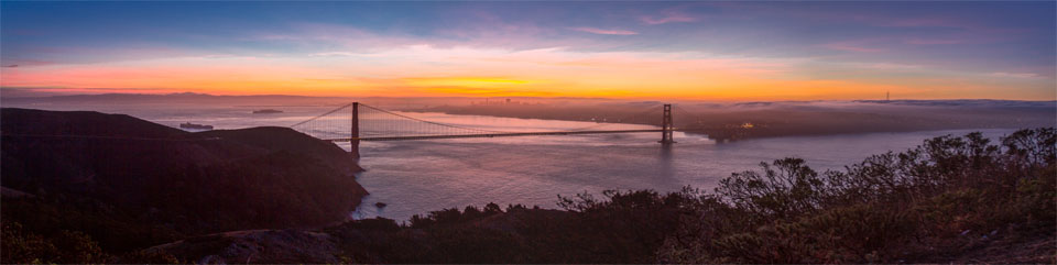 View of the Golden Gate Bridge, taken from the Marin Headlands, looking towards San Francisco at sunrise.