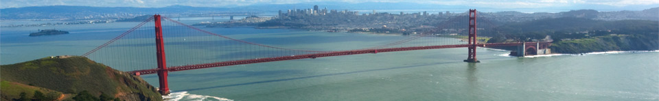View of the Golden Gate Bridge, taken from the Marin Headlands, looking across the bay back towards San Francisco, seen in the distance.