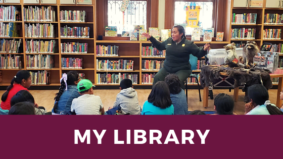 Ranger Fatima at Mission Branch Library telling a story in 2019.