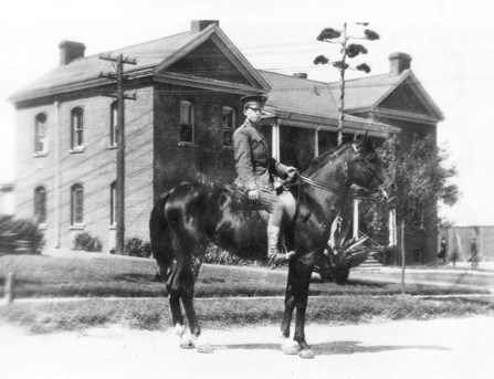 view of mounted soldier in front of historic brick building