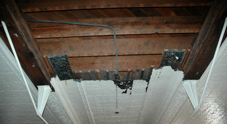 image of tin-pressed ceilings being rehabilitated