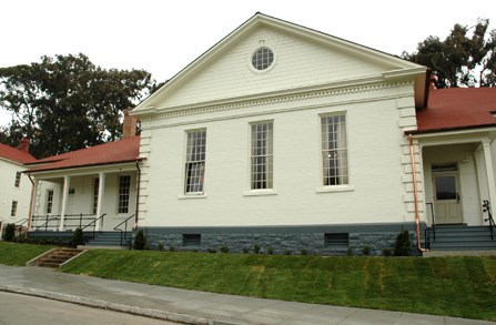 Fort Baker gymnasium which is white-painted brick with red roof
