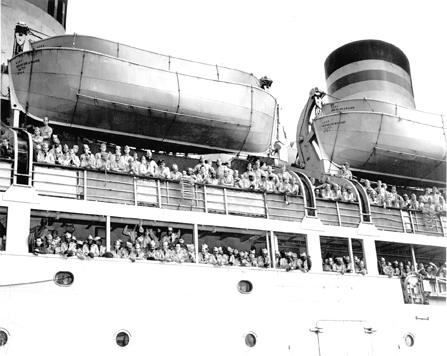image of soldiers crowded on a ship's deck
