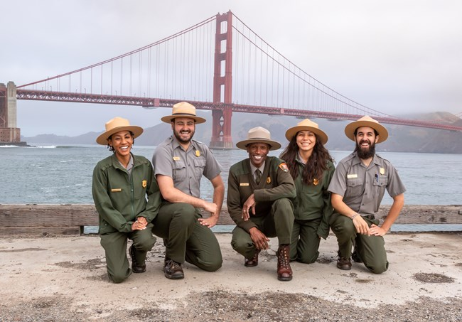 Education Rangers smile and pose in front Golden Gate Bridge.