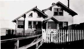 A photograph of the lighthouse keeper's house, formerly the fog signal building, circa 1924.