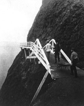 A photograph of the wooden walkway circa 1876, that was used before the construction of the tunnel on the Point Bonita trail.