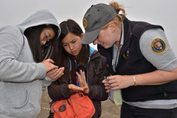 Students take a close look at the Rainbow Sands of Rodeo Beach